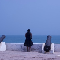 Academic professor, researcher and sometimes tourist Dr. Michelle Commander looks out to the ocean at Cape Coast Castle.